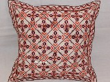 Pillow with a thic cross stitch  bonded in colors of brown and orange, size 40/40cm