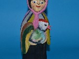 Folk sculpture. The rural woman from a rooster, H 22 cm