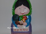 Folk sculpture in wood. The rural woman with a rooster
