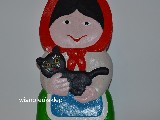 Folk sculpture in wood. The rural woman with a cat